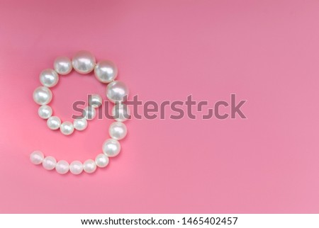 Large pearl on a pink background #1465402457