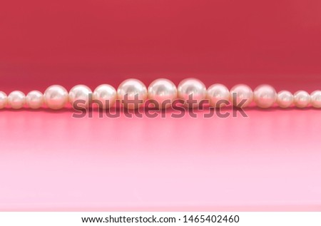 Large pearl on a pink background #1465402460