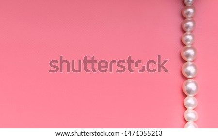 Large pearl on a pink background #1471055213