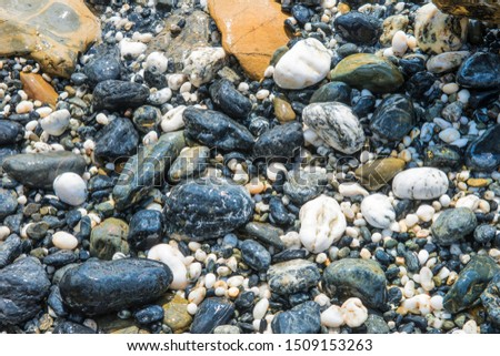 Large pebble washed ashore in Lilli Lilli beach in southern NSW. Australia, the pebbles come in all sizes and color.