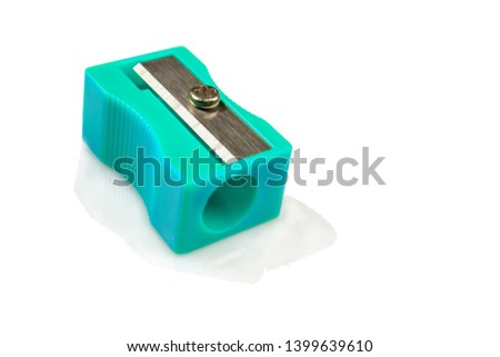 Large pencil sharpener on a white isolated background, close-up with space for the text.