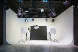 Large photography and video studios with white and black backgrounds and studio lights for arranging various forms of lighting With many sizes suitable for the job