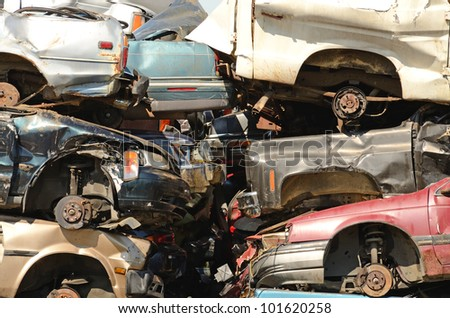 Large pile of automobiles after being crushed for metal recycling - stock photo