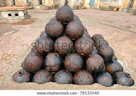 Large pile of cannon balls in a pyramid shape