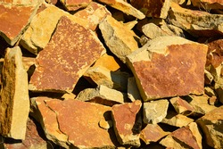 Large pile of sandstone stones close up