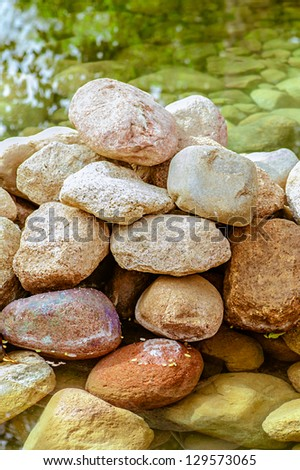 Large pile of stones laid out in bottom of creek.