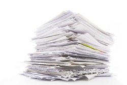 Large pile of waste paper isolated on white. Ready for recycling
