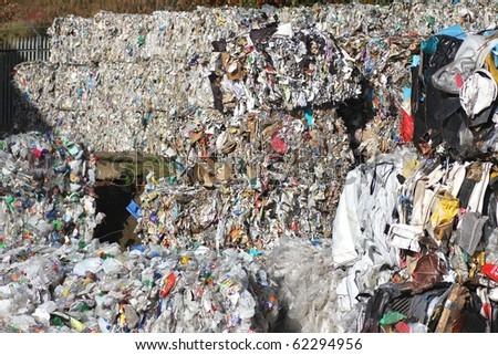 Large piles of recycling waste in recycling centre