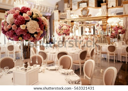 Large pink bouquet of hydrangeas and roses stands on dinner table in luxurious hall Сток-фото ©
