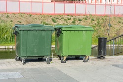 large plastic trash cans on the city waterfront