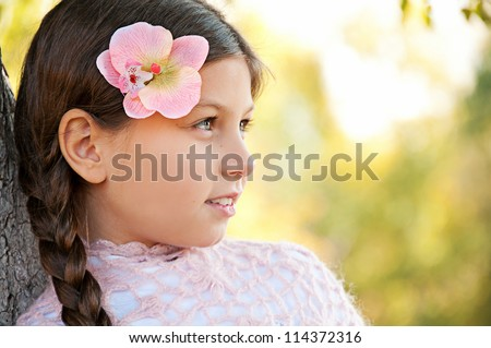 Large portrait of beautiful little girl with long braid