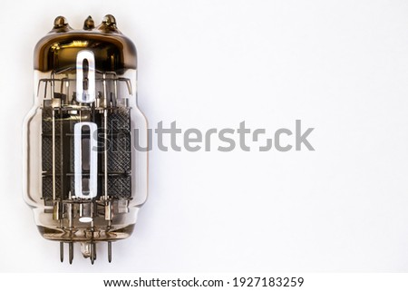 Large power electron tube for HiFi audio amplifier. Artificial light from above, top shot of the subject