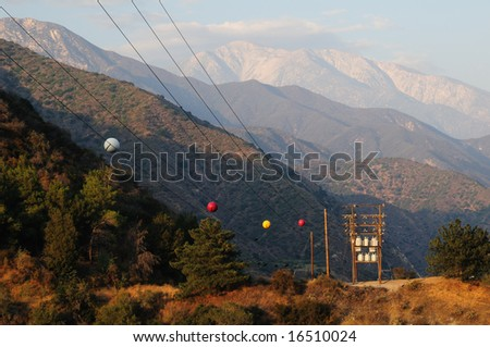 stock-photo-large-power-line-with-marker-balls-travels-through-the-mountains-16510024.jpg