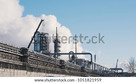 Large power plant with pipes and tanks stock photo