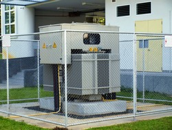 Large power transformers are installed outside the building and a fence around it. To convert AC power to high voltage AC and low voltage electricity to control fixed for large buildings.