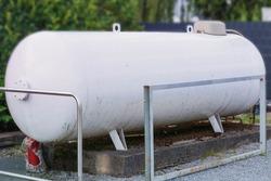 Large propane gas tank or liquid gas tank in a garden.