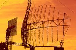 Large radar installation against a bright sky