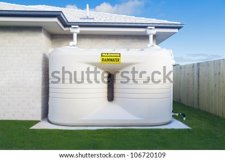 Large rain water tank in suburban backyard