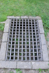 Large rectangular iron drain. Drain from a Medieval abbey in England.