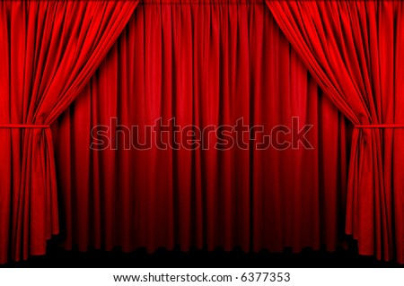 Large red curtain with spot light and fading into dark. - stock photo