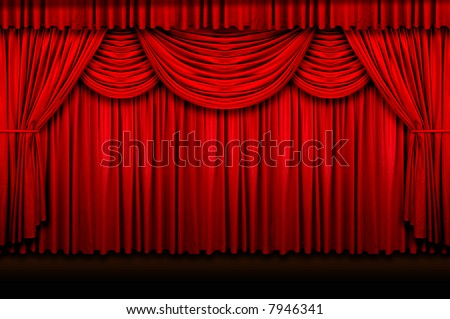 Large red stage curtains over wooden floor