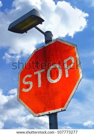 Large red Stop sign with.