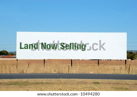 Large Roadside Billboard advising of land for sale