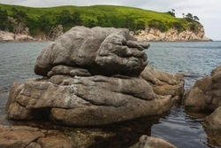 Large rocks on the beach, summer seascape.