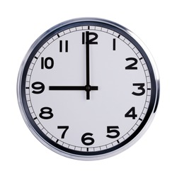 Large round office clock shows nine o'clock