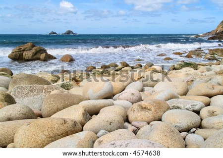 Large round stones on Porth Nanven beach, Cornwall, UK.
