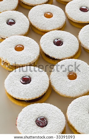 Large round sugar-coated cookies filled with apricot and raspberry jelly.