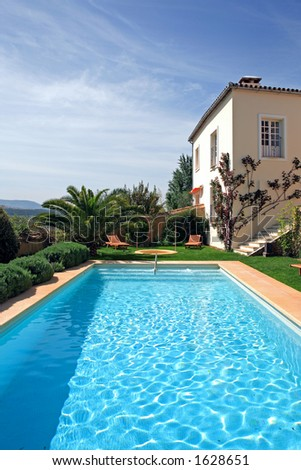 Large rustic hotel and swimming pool set in beautiful gardens in the spanish countryside stock for What is swimming pool in spanish