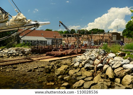 Large sailing vessel and dry dock ship maintenance yard in Maine harbor
