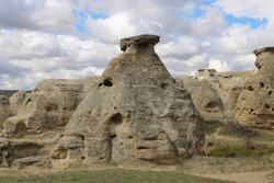 Large sandstone hoodoo with holes. Writing-On-Stone Provincial Park Alberta, Canada.