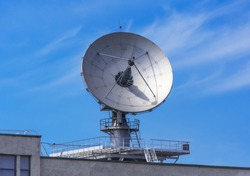 Large satellite communication parabolic dish radar antenna station or astronomical observatory space radio signal telescope.