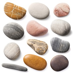 Large set of sea stones isolated on a white background. Top view of a collection of smooth pebbles. Stacked photo