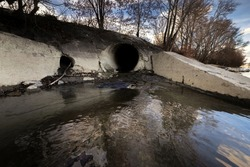 Large sewage tunnel with filth flowing out