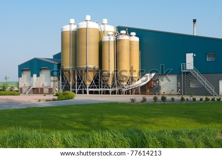 large silos in several sizes on a dutch farm