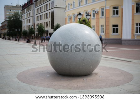 large smooth smooth ball in the city
