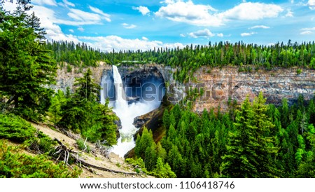 Large snow melt in the Cariboo Mountains creates spectacular water flow of Helmcken Falls on the Murtle River in Wells Gray Provincial Park near the town of Clearwater, British Columbia, Canada #1106418746
