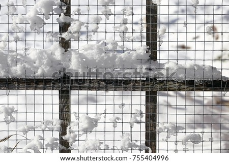 Large snowflakes on a metal grid. Metal grid with snow #755404996