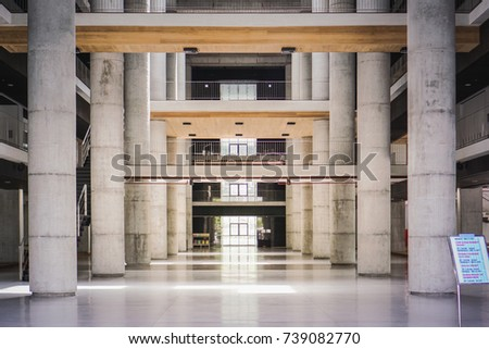 large space hall room of convention hall with large column with raw concrete brutalism architecture style #739082770