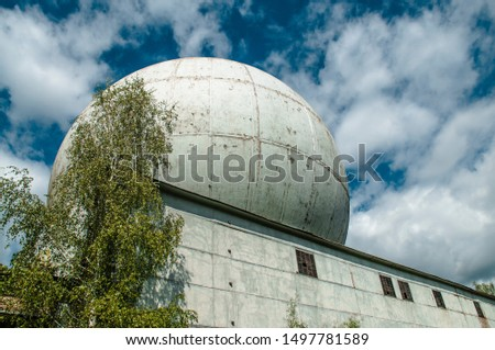 Large special radio location station construction, non-working telecommunication building, old huge antenna sphere, meteorology equipment, connecting technologies. Abandoned building #1497781589