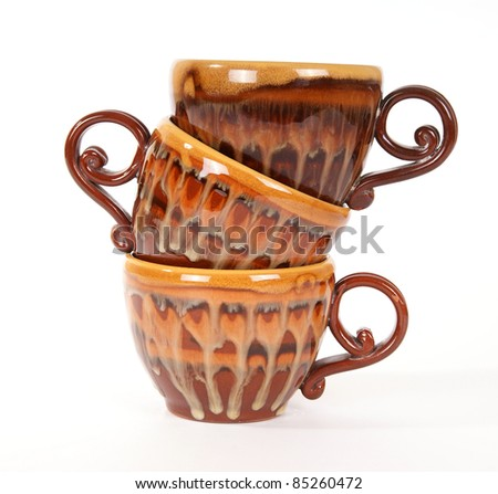 large stack of ceramic tea cups closeup, isolated on a white background