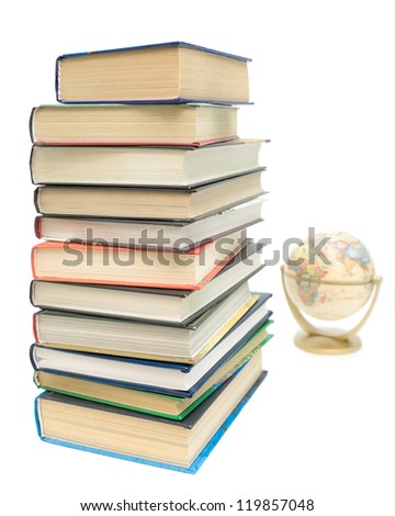 large stack of different books and globe isolated on white background