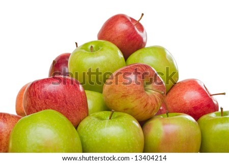 Large stack of green and red apples isolated on white