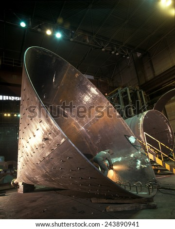 Large steel cone being manufactured #243890941