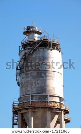 Large steel storage tower on Spanish industrial estate