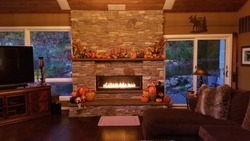 Large Stone Fireplace with Flames, at Dusk in a Rustic Home During the Fall Season