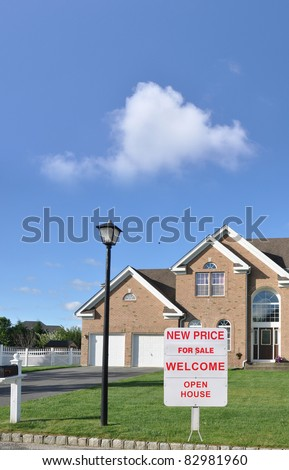 Large Suburban Luxury Home with For Sale, Welcome, Open House Sign on Lush Green Lawn in Late Afternoon - stock photo